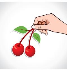 Cherry in hand vector image