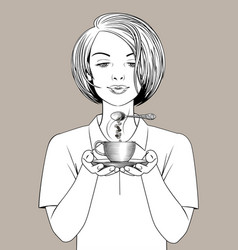 Girl holding in her hands a coffee cup and spoon vector