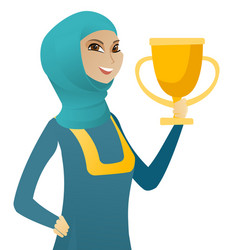 Young muslim business woman holding a trophy vector