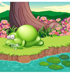 A monster lying at the riverbank vector image