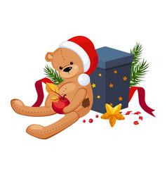 cute teddy bear in a christmas hat sitting near vector image