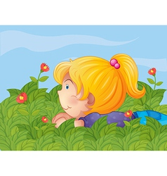 A little girl hiding in the garden vector