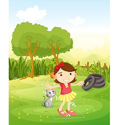 A girl playing at the park with her cat vector image vector image