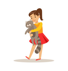 cute girl holding a gray cat on her hands vector image