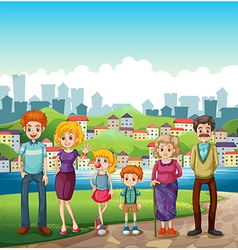 A family at the riverbank vector image