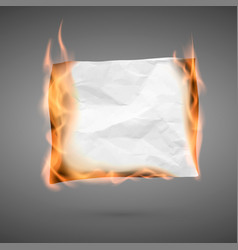 Burning piece of crumpled paper with copy space vector