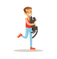 smiling boy holding a black cat on his hands vector image vector image