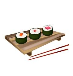 Shrimp nigiri and squid nigiri on bamboo mat vector