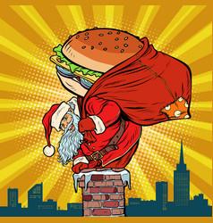 santa claus with a burger climbs into chimney vector image