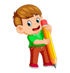 a young boy holding big pencil vector image
