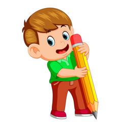 a young boy holding big pencil vector image