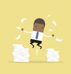 Businessman jumping and a mountain of documents vector