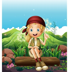 A smiling girl resting near the rocks vector image
