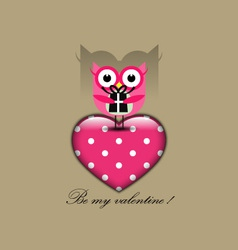 Cute owl holding a gift vector image
