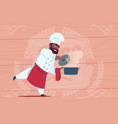 African american chef cook holding saucepan vector