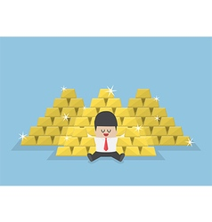 Businessman sitting with a pile of gold bars vector