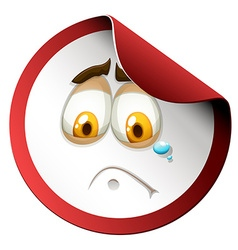 Crying face on round sticker vector