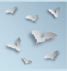Flock of bats in paper art style on a light blue vector