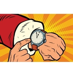 Santa Claus shows the clock nearly midnight vector