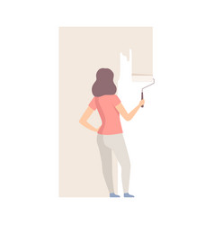 woman paints the wall with roller in ivory flat vector image