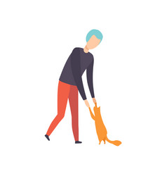 young man playing with his cat adorable pet and vector image