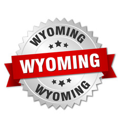 Wyoming round silver badge with red ribbon vector