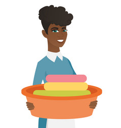 african housewife holding basin with dirty linen vector image vector image