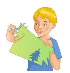 Boy is cutting color paper with scissors vector image
