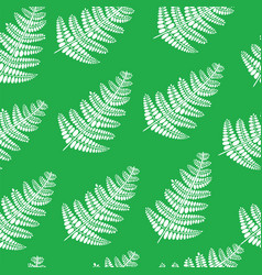 Fern branch on green - seamless doodle pattern vector
