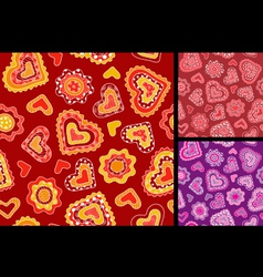 Seamless hand-drawn hearts patterns vector image