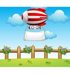 A stripe blimp carrying an empty banner vector