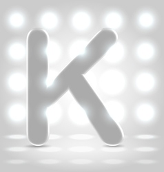 K over lighted background vector image vector image