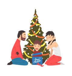 happy family sitting next to christmas tree cute vector image