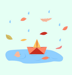 Orange paper boat in a puddle of water vector