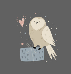 cute an owl sitting on a gift box vector image