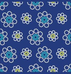 geometric flowers seamless pattern on a navy blue vector image