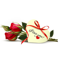 Two red roses with an I Love You note vector image vector image
