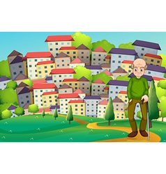 A grandfather at the hilltop across the village vector image