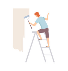 Painter paints the wall with roller standing on a vector