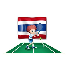 A boy playing tennis in front of the Thailand flag vector image