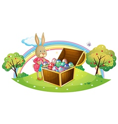 A bunny with many coloful eggs vector image vector image