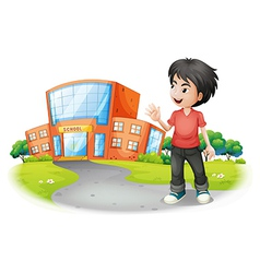 A boy standing in front of the school vector image vector image