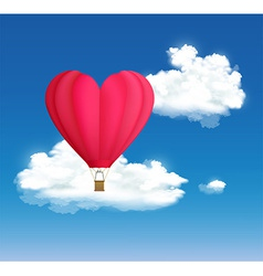 Hot air balloon in the shape of heart on the vector image
