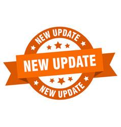 New update ribbon new update round orange sign vector