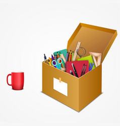 office accessories in a cardboard box with a mug vector image