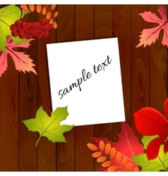 Autumn leaves on wood background vector image vector image