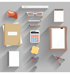 Calculator ruler and paper on an office desk vector