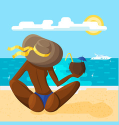 A young woman in a hat sits on sandy beach vector