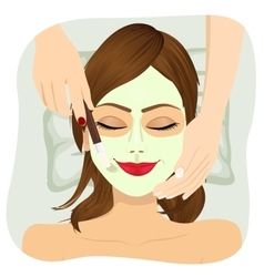 Beautiful woman with cosmetic mask on face vector image vector image