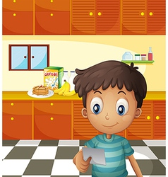 A boy reading a recipe vector image